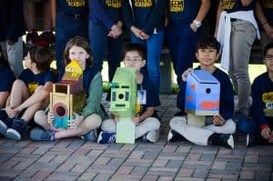 Youngblood Intermediate students sit with their birdhouses