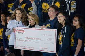 Beth Rohani with the IMD present Youngblood Intermediate with a check.