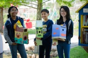 Youngblood students with their handmade birdhouses